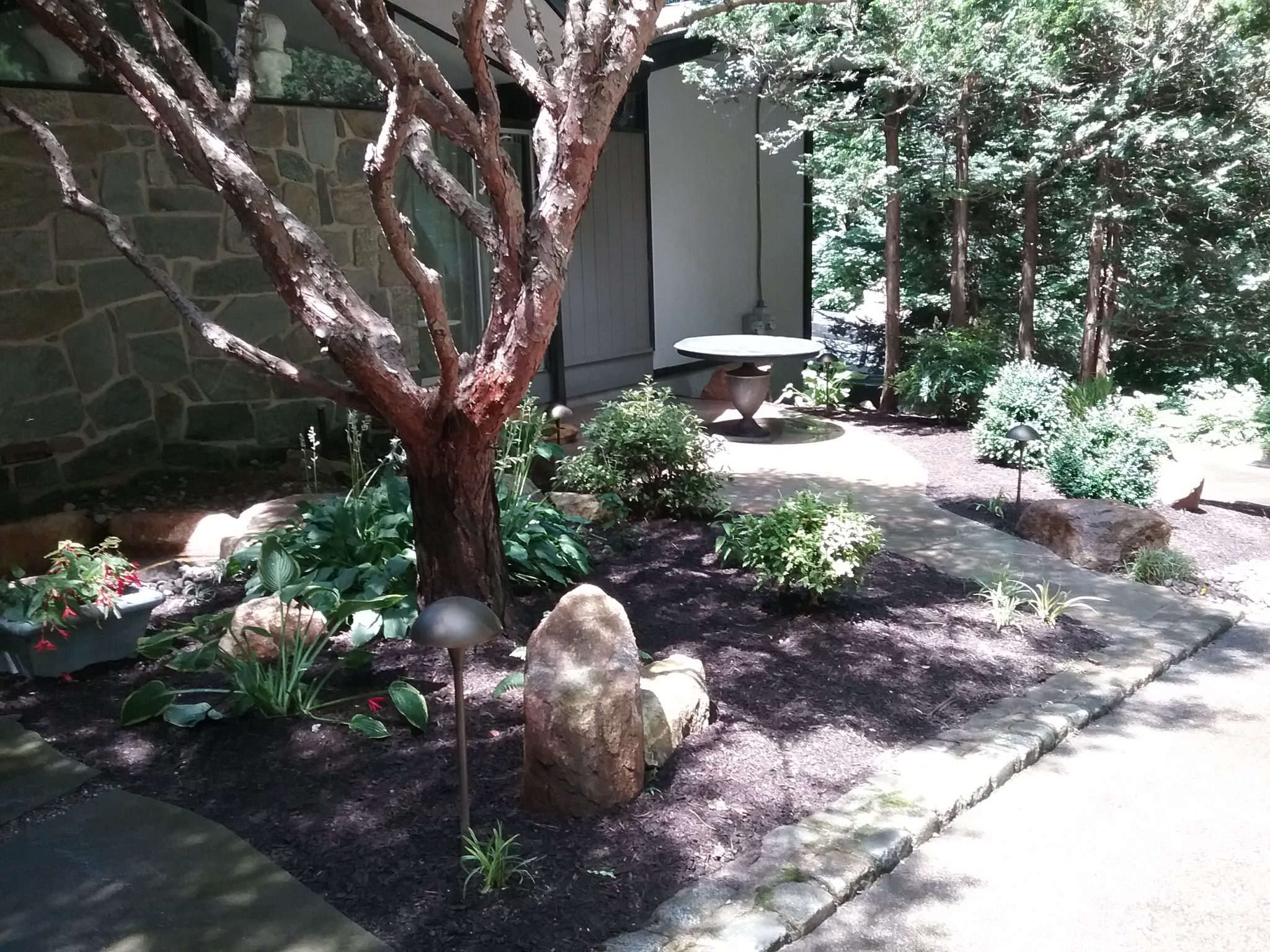 Landscaping, hardscaping and lighting- After